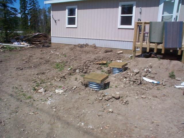 here we have another house that just got renovated. as u can see there are only boards covering up the well n septic tank.